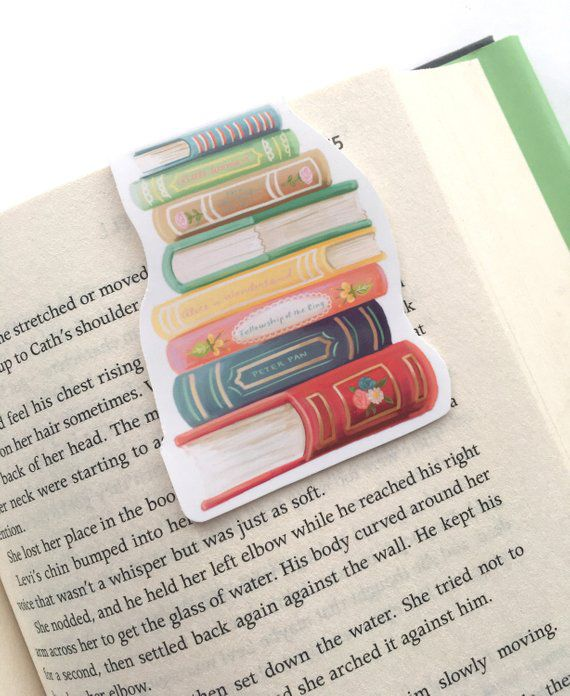 Illustrated book stack magnetic bookmark on a page