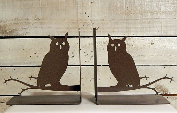 metal owls on a branch bookends