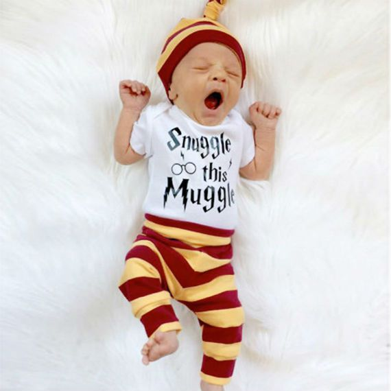 "yawning baby wearing striped leggings and hat and harry potter ""snuggle this muggle"" onesie"