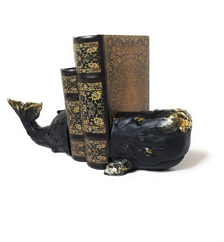 dark whale bookend with distressed parts showing bronze