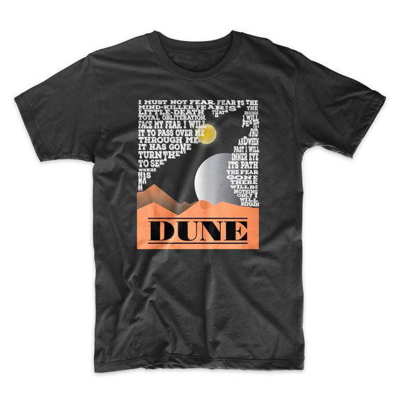 "black t-shirt with white text, negative space in the text creates outline of sand snake from Dune by Frank Herbert. The title ""Dune"" is written in black text at the bottom."