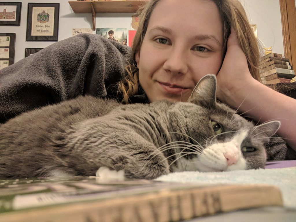 Reading books with my cat