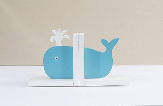 bright blue whale bookend with water spout and googly eye