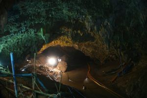Photo of entrance to cave with spotlight shining