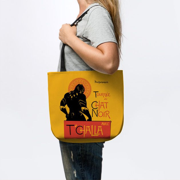 Woman carrying yellow tote with black straps. Tote has an image of Black Panther in the style of famous French art print.