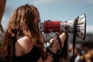 woman shouting protesting with megaphone