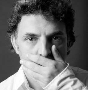 Photo of etgar keret, one of the best authors of magical realism short stories.