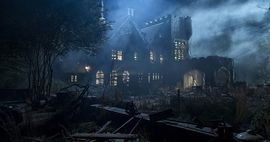 Promotional image of Hill House from the Netflix series. A large, run-down, spooky house, surrounded by fog.