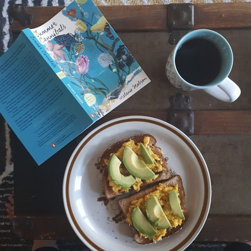 Image of tea, avocado toast, and book Summer Cannibals by Melanie Hobson in Classic Novels as Millennial Clickbait | BookRiot.com