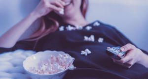bookish tv shows woman eating popcorn television feature