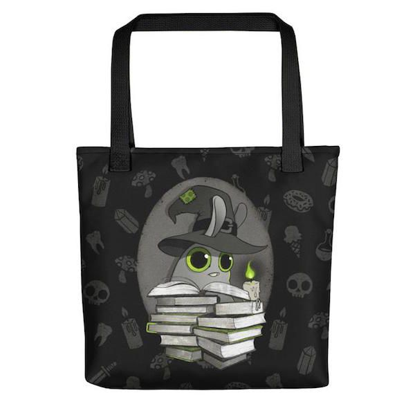 black tote bag with graphic art of bunny wearing witch hat with stack of books