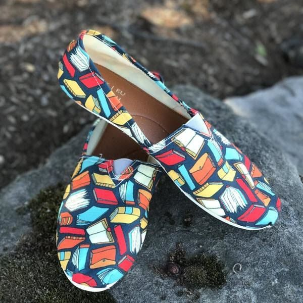 Slip-on shoes with book print