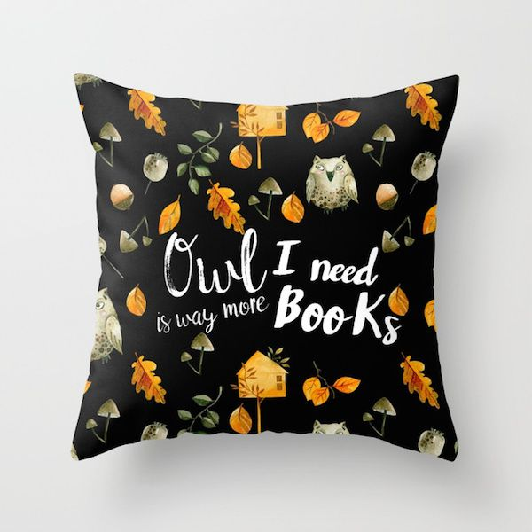 """square black pillow with orange leaves and owls print saying """"Owl I need is way more books"""""""