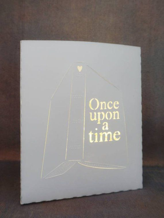 "Paper light shaped like a book that says ""Once upon a time"""