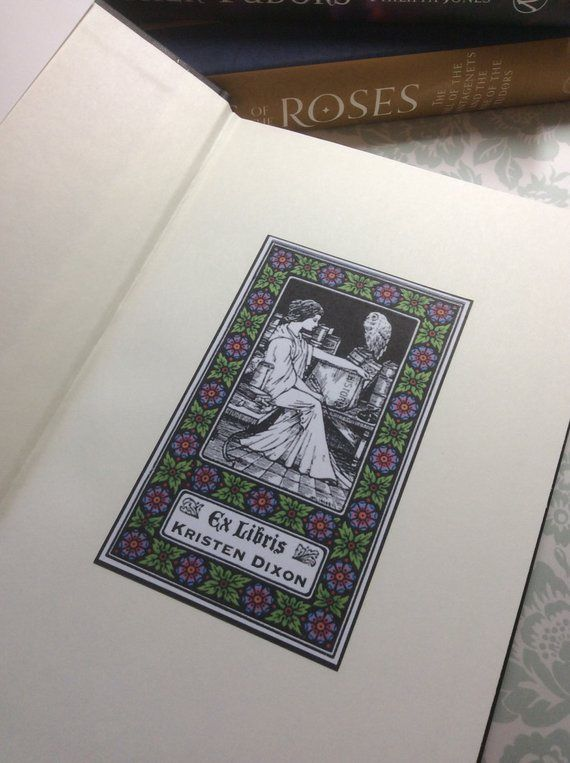 Ex Libris book plate with owners' name and image of a woman