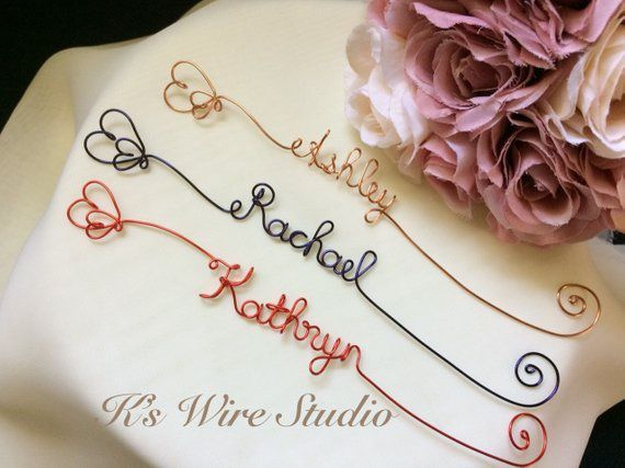 Three wire bookmarks shaped to form names