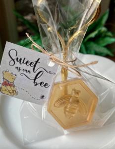 """Winnie the Pooh tag that reads """"Sweet as can be"""" on bee themed soap"""