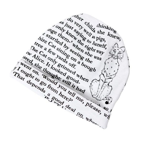 White baby cap with storybook text