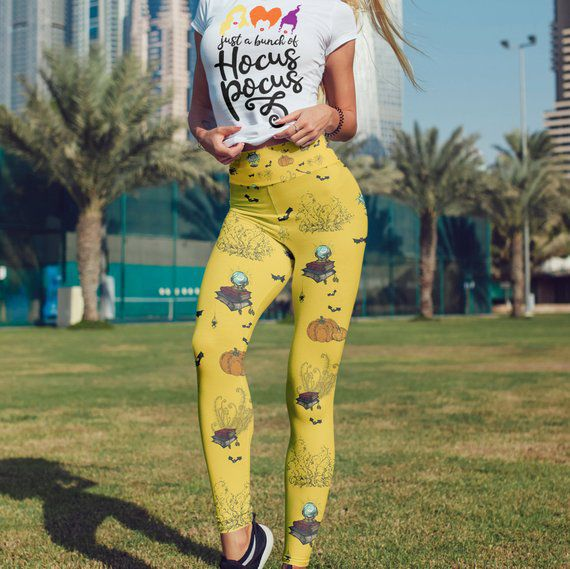 yellow leggings with book stacks, pumpkins and bats printed on