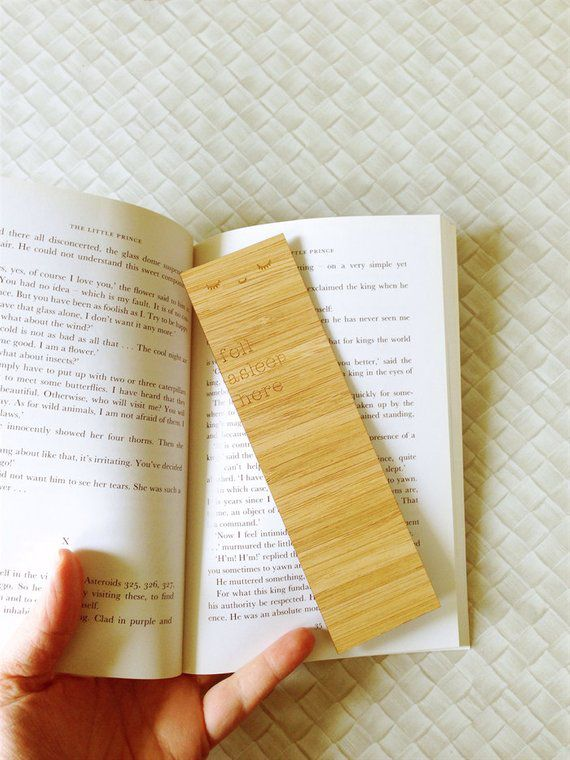"Bamboo bookmark engraved with sleeping eyes and ""fell asleep here"""