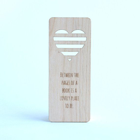 "Wooden bookmark with heart cutout and ""between the pages of a book is a lovely place to be"" quote"