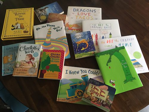 Books received at a baby shower.