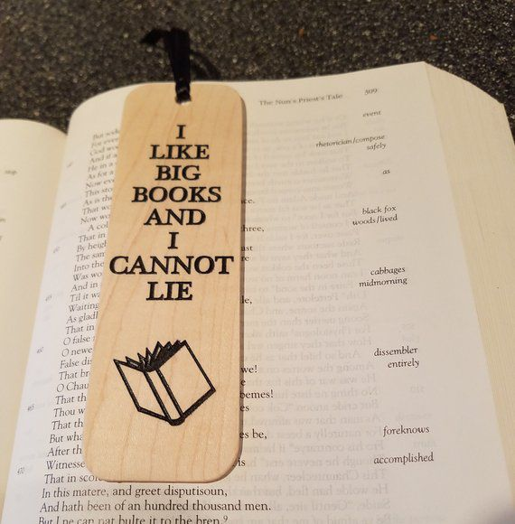 "Wooden bookmark with ""I like big books and I cannot lie"" quote"
