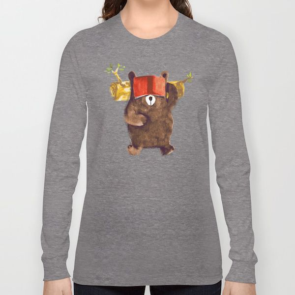 graphic drawing of brown bear laying down with open book over his eyes on a grey long sleeve t-shirt