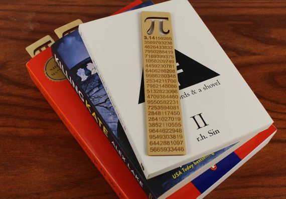 Wooden bookmark with pi symbol cutout and engraved with pi decimal