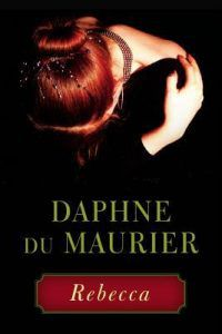 Cover of Rebecca by Daphne du Maurier. There is a woman with red hair looking down. Everything around her is black.