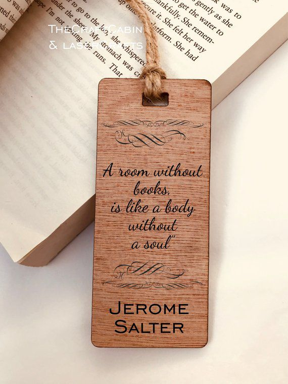 "Wooden bookmark engraved with ""A room without books is like a body without a soul"" quote"
