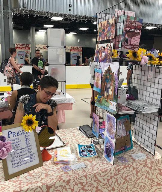 Alex Grandstaff displays their comics and art at STAPLE! 2018