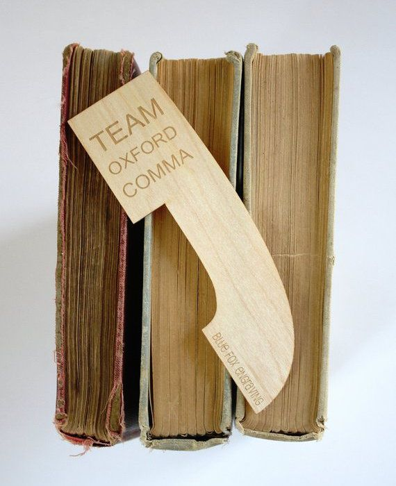 "Comma-shaped wooden bookmark engraved with ""Team Oxford Comma"""