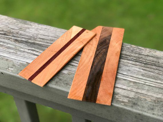 Two wooden bookmarks with vertical stripe of darker wood in center