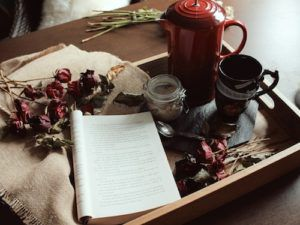Photo of a book on a tray with tea and sugar