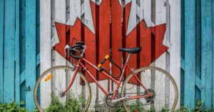 bike leaning against Canadian leaf