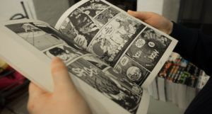 person holding an open manga