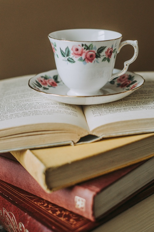 Photo of teacup on stack of books