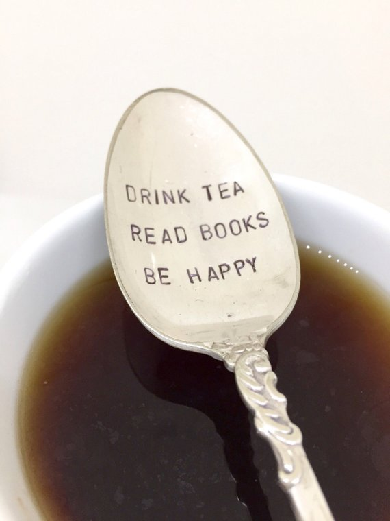 vintage tea spoon stamped with the phrase drink tea read book be happy