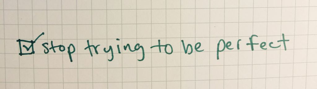 """bullet journal grid paper that says """"stop trying to be perfect"""""""