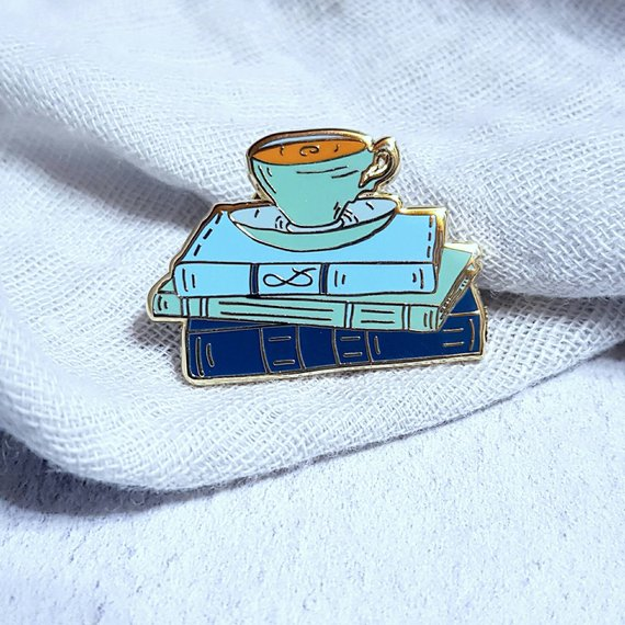 teacup on a stack of books enamel pin