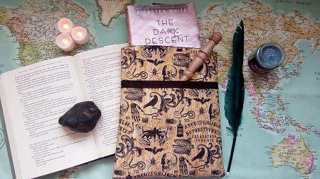 Ouija board themed book sleeve