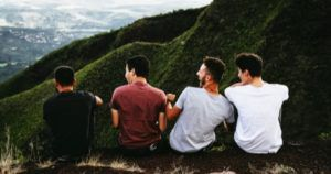 reverse harem romance novels feature, male friends hanging out in nature