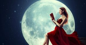 woman reading in front of moon feature 470x248