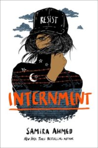 """Internment cover - woman with """"resist"""" hat"""