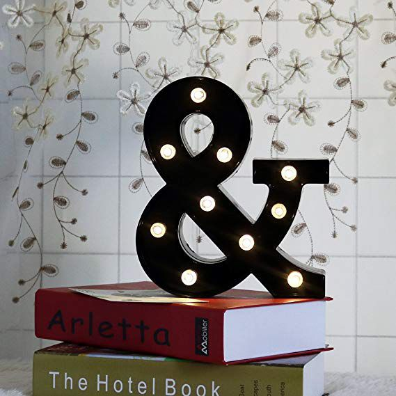 ampersand on a stack of books