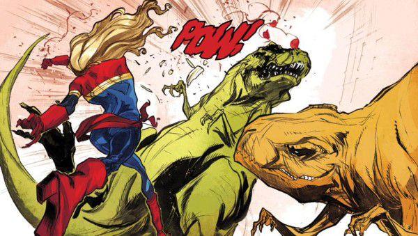 Captain Marvel punches a dinosaur