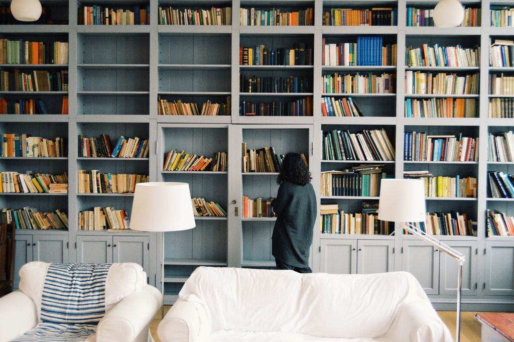 Woman looking at shelf of books