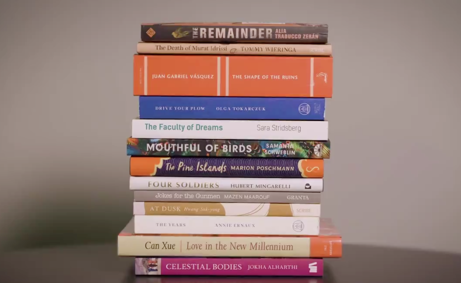 Stack of books in front of grey background