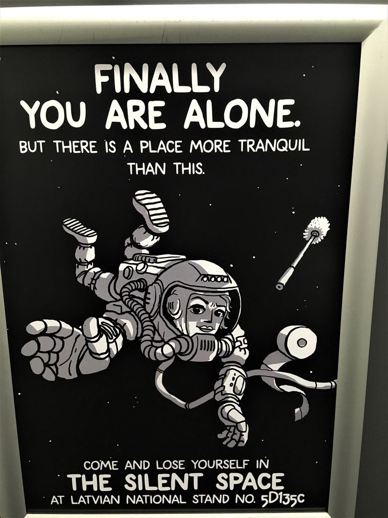 "black poster featuring an astronaut, a toilet cleaning brush, and toilet paper, reading ""Finally you are alone"""